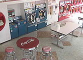 Red, white and blue washing machines, a laundromat in Japan.