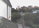 Webcam looking onto the pond, patio and gardens at Hill Farm Bed and Breakfast.